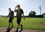 (105) Chris Ianetta, left, and Todd Helton walk across the field during Colorado Rockies spring...