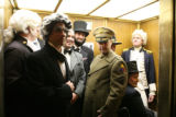 Members of the President's Day Society board an elevator to leave the capital after visiting the...
