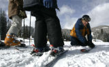 Todd Metz explains how a ski edge works to kids in a lesson at Winter Park, Friday February 14,...