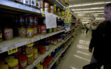 Dan Stone looks over the selection of peanut butter at the King Soopers in Denver, Colo. Monday...