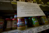 A sign hangs above Kroeger products to allay fears at the King Soopers in Denver, Colo. Monday...
