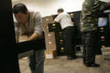 Sunny wong, Sonny Risley and Darryl Wright (l to r) go through files in the appeals office inside...