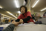 Jong R. Lee (cq) owner of JSK Trading inside La Plaza Mexicana 10061 East Colfax Ave., on Tuesday,...