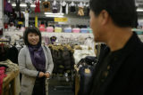 Gina Shin (cq) owner of Bonita Fashion for six years talks with her husband Young Yoo (cq) inside...