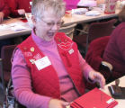 Volunteer Susie Semersheim (cq) laughs during  the Valentine Re-Mailing Program at the Loveland...