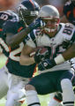 Denver Bronco's safety, Nick Ferguson, left, pulls down New England's Tim Dwight, rignt, in the...