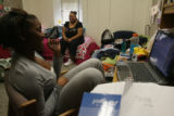 Toswanette Neal (cq), 18, hangs out with her room-mate, 18-year-old Paradise Lynette Moore (cq),...