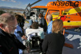 (from left) Gary Drotar (cq), a pilot with Air Methods since 1983 helps transport a patient into...