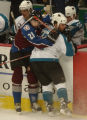 (Denver,CO,Shot On 4/28/04-- Colorado Avalanche Peter Forsberg and San Jose Sharks Mark Smith run...