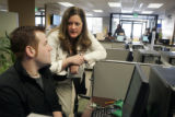 Erin Carney helps Jeremy Pugh put together a resume on the computer  at the Arapahoe/Douglas...