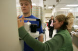 DM0514   Medical assistant Yadira Pastrana measures 18-yearold Nathan Heuer's weight as he checks...