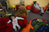 SR(054) In front, three-year-old Karla Escamilla, of Commerce City takes a seat on a stuffed...