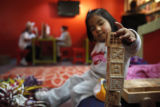 SR(206) Three-year-old Karla Escamilla of Commerce City plays with letter blocks while her older...