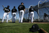 (0878) from left-Clint Barmes, Troy Tulowitzki, Garrett Atkins and Jeff Baker wait outside the...