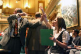 Rep. Larry Liston (cq) R-Colorado Springs, holds up the arm of Jamie Heffelberg (cq) an 8th grade...