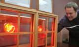 Richard Gaines (cq) Vice President of Liqcrytech Future Glass demonstrates the energy effectivness...