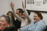 Kelly Plefner signs applause seated with Kendra MacNicol (l-r) during testimony for HB 1090 at the...