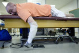 Donald Roberts works out during a rehabilitation session at Spalding Rehab Hospital in Aurora on...