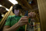 Jordan Brown, 17who is a student at Warren Tech learns how to wire an electrical switch at Red...