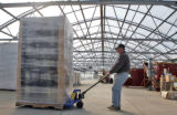 Station Manager Art Sims (cq) moves construction materials at Bonnie Plants Greenhouse in LaJunta ...