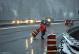 State of Colorado department of Transportation worker, Val Unrein (cq), moves traffic cones from...