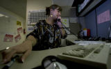 Cyndi Goodman answers question from a caller at Brothers Redevelopment, Inc in Edgewater, Colo....