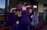 "The 'Radiant Rubies,"" women who wear red hats,  Joan Ruch and Jackie Lorentzson (l-r) picked..."