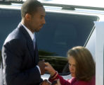 NBA star Kobe Bryant helps his attorney Pamela Mackey get out of their vehicle as they arrive at...