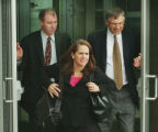 Kobe Bryant's defense attorneys Terry O'Connor, left, Pamela Mackey, center, and Hal Haddon leave...