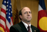 U.S. Attorney John Suthers, talks to the media at the Colorado State Capitol on Thursday, Dec. 9,...