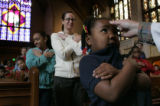 Loyola Grade School student Laila Ashley Thomas, 7, celebrates Ash Wednesday with the rest of the...