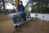 390  Kelly Grizzell,  visits the grave site of her daughter, Stephanie Hart Grizzell, 16, and...