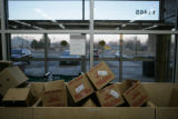Boxes that contained products for store use wait to be used as bag to hold groceries at Vitamin...