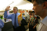 225  Governor Bill Ritter, left, greets members of the Rocky Mountain News as he visited Publisher...