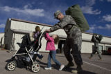 DM0147  Audrey Rizzuto, 4, of Colorado Springs helps her daddy, Sgt. Jason Rizzuto, push the...