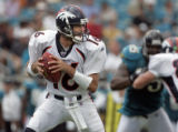 Denver Broncos' quarterback Jake Plummer (#16) drops back to pass against the Jacksonville Jaguars...