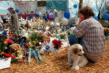 RMN120--MEMORIAL, CLEMENT PARK-- Melissa Mack of Bennett, Colorado, and her puppy...