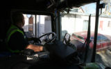 Mark Duran Sr. (cq) drives a trash truck through a tight spot in an  alley  near 8th ave. and...