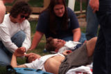 RMN123-4-20-99-Denver,Co.--Emergency personal work on the wounded at the triage scene near the...