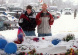 RMN124-4-22-99- Two teenagers pray at a memorial in Clement Park for their fellow students who...
