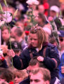 RMN125-DENVER,CO.- 4-25-99-A little girl joins hundreds of mourners raising their flowers to the...