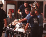 RMN126-4-20-99-Denver,Co.-A wounded student is worked on by emergency personel as they arrive at...