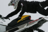Steve Martin (cq) rides during the snowmobile speed and style seeding during the Winter X games at...