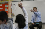 Richard Hobson, 25, aTeaching Fellows selects a student to answer a question at Colfax Elementary...