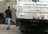 Unknown person leaves Executive Recycling as federal agents execute Federal search warrants at...