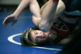 0102 Pondarosa's Daniel Kelly tumbles in a match that he won beating Green River Ranch's Scott...