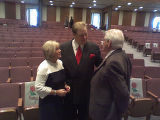 Pastor Tim Stearman and wife Jane say goodbye to Harold Fleshman member of the flock photo...