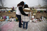 SR(077) Fourteen-year-old Sonya Romero is consoled by her mother Cindy Romero, 47, on a frigid...
