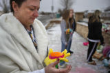SR(140) Teresa Couture, 50, of Westminster takes a moment on a frigid Sunday afternoon, Jan. 25,...
