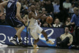 Chauncey Billups (cq) of the Denver Nuggets dribbles by Kosta Koufos (cq) of the Utah Jazz during...